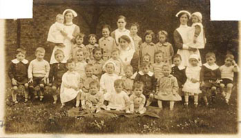 Smaller children, like these ones here, were allowed to wear informal and casual clothing more often than the older children, who were encouraged to wear more uniformed dress.