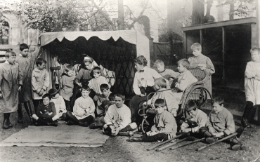 Boys and staff in the garden at St. Martin's Home for Boys, Surbiton, Surrey