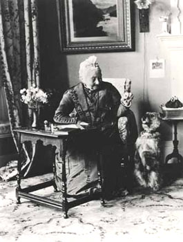 The home's pet was a familiar character to everyone involved in the running of a children's home. This dog is shown with Miss Bailey, who was the wife of St Andrew's founder.