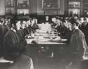 Boys eating in a dinning hall