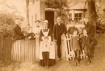 Knebworth Cottage housed only six boys, and it was one of the Society's smallest homes. We believe the man in the middle of the photograph to be the founder of the Home, Mr Jones.