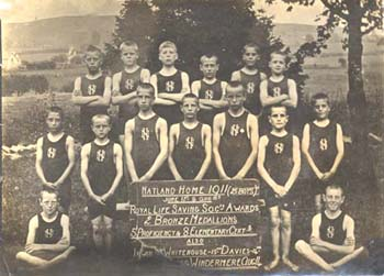 The Natland Home swimming team were highly regarded in the Society. They even visited other homes to give swimming displays to the children. Here they are shown with a plaque they received from the Royal Life Saving Society in 1911.
