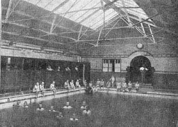 The boys from the Leicester Home enjoy the luxury of an indoor pool. The Society believed that swimming lessons gave the children important life-saving skills, as well as keeping them fit and healthy.