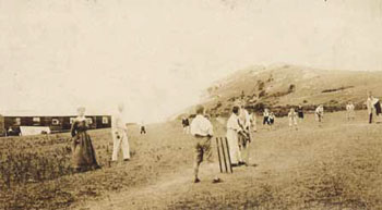 The Welsh hills around Dyserth provide the scenery for this game of cricket. The children were on their summer holiday from the Sycamore Home in Moseley, Staffordshire.