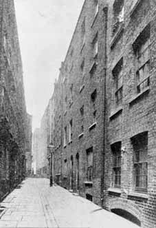 The problems of London poverty were foremost in Edward Rudolf's thoughts when he established the Waifs and Strays' Society. Many of the Society's first children came from deprived urban areas like the street shown here.